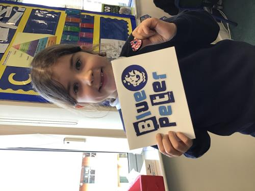 Eleri receives a Blue Peter badge