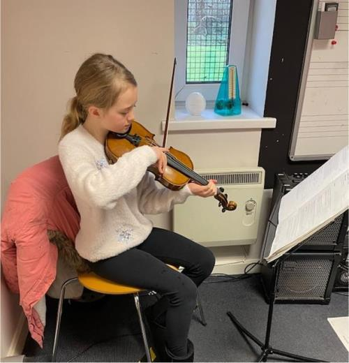 Sophie gains a distinction in her grade 2 violin exam